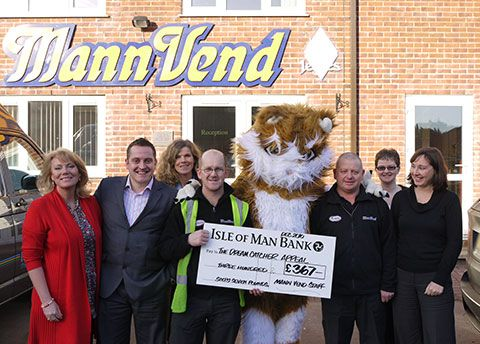 MannVend staff present a cheque to the Dream Catcher Appeal
