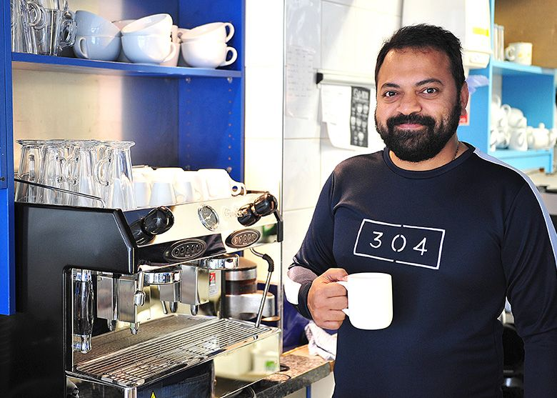 Shri Naik, owner of Scoops, with the barista coffee machine supplied by MannVend.
